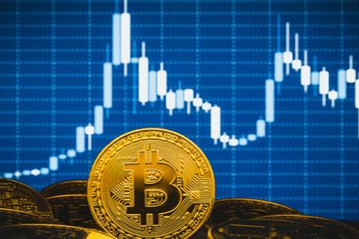01_An-image-of-Bitcoin-with-trading-chart-on-a-blue-background.jpg