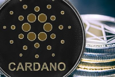 01_Cardano-on-the-background-of-a-stack-of-coins.jpg