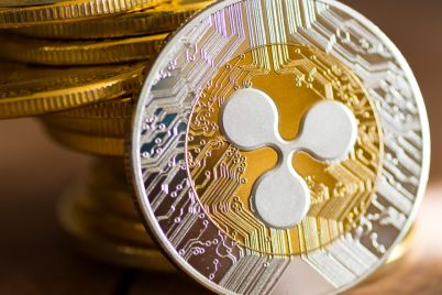 01_Pile-of-coins-and-gold-XRP-on-wooden-background.jpg
