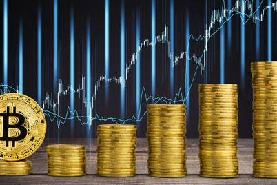 01_Stack-of-bitcoins-on-chart-background.jpg