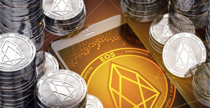 02_Smartphone-with-EOS-symbol-on-screen-among-silver-EOS-coins.jpg