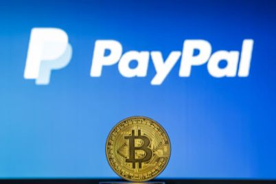 03_Bitcoin-on-a-stack-of-coins-with-PayPal-logo-on-a-laptop-screen.jpg
