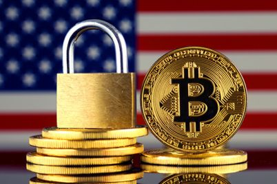 05_An-image-of-Bitcoins-and-a-golden-padlock-with-a-US-flag-background.jpg